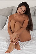 Elsa D is naked on the bed