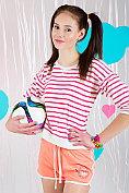 Football-playing teen Kora gets her kit off