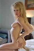 Blonde babe Lorna Moore in her bedroom