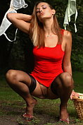 Cathy Long shows off in the garden without any knickers on