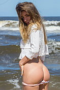 Natalia E strip naked at the seaside