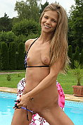 Sara Kay makes a proper exhibition of herself out by the pool