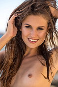 Edessa G takes off her bikini on the rocks down by the sea