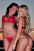 Ashley Emma and Sammi-Jo watch the sunset together in their lingerie