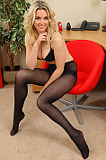 Stacey M teases and strips in the office